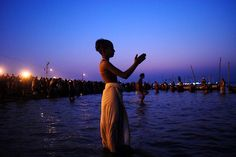 Hindu devotees perform rituals and take a holy dip. Hindus believe that bathing in the Ganges cleanses them of ther sins