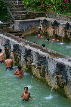 Enjoying the holy hot springs of Air Panas Banjar - Bali, Indonesia