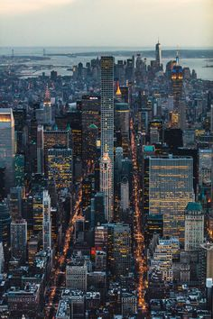 Manhattan at dusk - The Best Photos and Videos of New York City including the Statue of Liberty, Brooklyn Bridge, Central Park, Empire State Building, Chrysler Building and other popular New York places and attractions.
