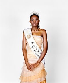 In August 1993, a 21-year-old woman from Soweto was named Miss South Africa, becoming the first black woman to win the title in the 37-year history of the pageant.  Finalist.  Miss South Africa Competition.  Sun City, South Africa.