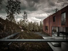 Rugged Corten Steel Clads Minimalist 'House for a Photographer...