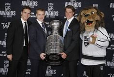 Los Angeles Kings Luc Robitaille, Dustin Brown, Anze Kopitar and mascot Bailey at the 2014 NHL Awards in Las Vegas (June 24, 2014)