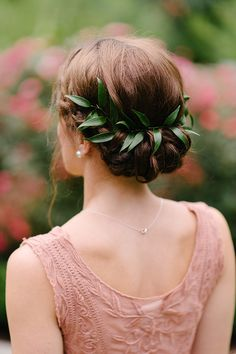 Italian Ruscus tucked into a twisted updo for a touch of whismy. #wedding #hairstyle