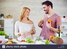 http://c8.alamy.com/comp/FGJX8M/laughing-girl-looking-at-her-boyfriend-playing-with-citrus-fruits-FGJX8M.jpg