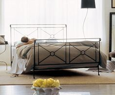 Campaign Bed with wrought iron finish, hand forged from thick, solid iron bars, the finish is achieved in layers and has a unique luminosity. #ironbed #CharlesPRogers #beds