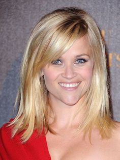 WITH BANGS Side-swept bangs and long layers add swingy movement and make Reese Witherspoon's cut feel youthful. If you have fine hair, Buckett suggests starting your bangs farther