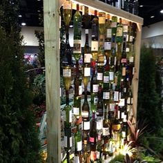 Great ideas to re-purpose your used wine bottles as garden art, edging, tiki torches, and more! Wine Bottle Fence, Wine Bottle Tiki Torch, Old Wine Bottles, Wine Bottle Candles, Wine Bottle Fountain, Antique Bottles, Vintage Bottles, Vintage Perfume, Antique Glass
