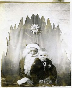 According to the boy in this photo, describing the event as an adult, Santa was so drunk that he was almost unable to stay upright and smelled as if he'd been drinking since the previous Christmas. Hahaha! Fabulous snapshot of a department store Santa and a little boy! I love how Santa's mustache is in his mouth! Hahahaha!