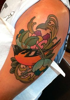 Neotraditional style baltimore oriole bird tattoo on the for Best tattoo shops in baltimore
