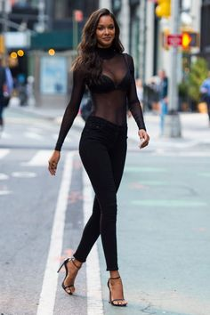 Lais Ribeiro championed this season's love of the sheer top wearing a see-through body with jeans and strappy sandals.