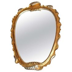 Italian carved gilt and silver gilt shell-form mirror | From a unique collection of antique and modern wall mirrors at http://www.1stdibs.com/furniture/mirrors/wall-mirrors/