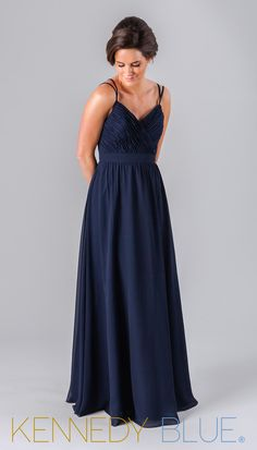 a8586d194fe5 A long navy bridesmaid dress with a v-neckline and beautiful strap detail  on the