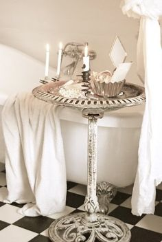 A Wonderful Shabby Idea….An Old Iron Birdbath as a Tub Side Table!
