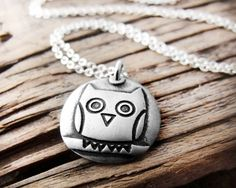 Silver owl necklace number 2 on silver chain. $38.00, via Etsy.