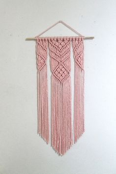 Perfect for a nursery!  https://www.etsy.com/listing/570500149/pink-macrame-wall-hanging