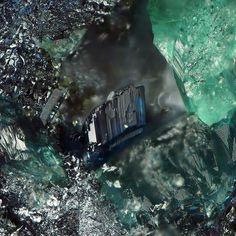 Keyite ~ Tsumeb Mine, Otavi Highlands, Namibia ~A single well developed blue keyite crystal on ore matrix between cuprian adamite.