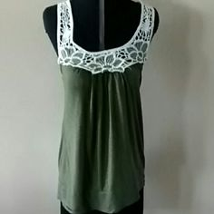 Halter Top Olive green with crocheted detail. There is a small hole on back bottom cuff that is not noticeable when wearing. Vanity Tops