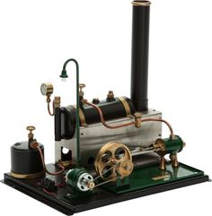 LIVE STEAM MODEL POWER PLANT TOY 16 x 16 x 11 inches (40.6 x 40.6 x 27.9 cm) Well engineered German model power plant with horizontal boiler...