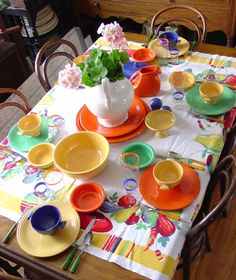 Vintage Fiesta© tablescape with period tablecloth, go-along glassware, and bakelite flatware.