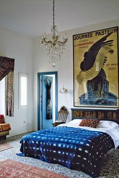 Interior decoration inspo: African indigo textiles, rug and chandelier