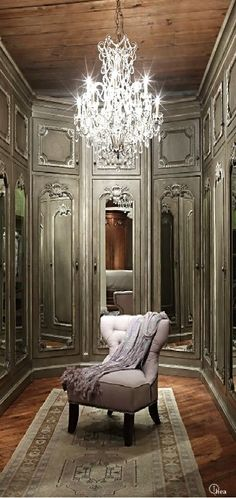 Softly glowing paint on boiserie - French dressing room...  I could just sit in that chair... and marvel that I was in the middle of the most wonderful closet in the world....