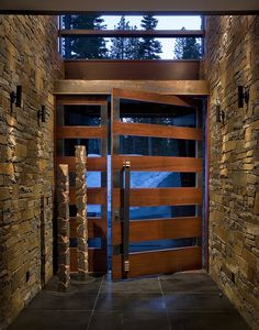 wood andglass doors | The pivot door was made with materials of wood, iron, ... | hall/entry