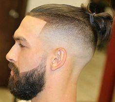 Sleek Mohawk Top Knot with High Fade