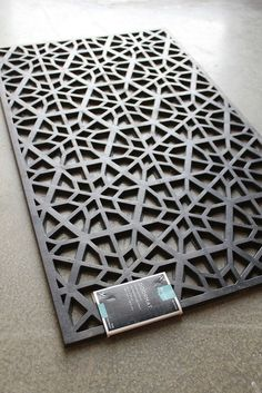 She saw a beautiful headboard at West Elm. This one: Couldn't afford it. But then she saw this door mat at Target and a light bulb went off: Now I can see what she saw, but only because she saw it first. Here is how she executed this project: According to karapaslaydesigns, after she spray …