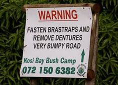 """Fasten your """"Bra-straps"""" ladies, bumpy road ahead! If you have dentures, please remove them too. (Signs in Africa). Funny Road Signs, Fun Signs, You Funny, Really Funny, Funny Stuff, Funny Things, Street Signs, Laugh Out Loud, Home"""