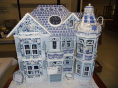 This is an amazing doll house made from china tea cups etc!!