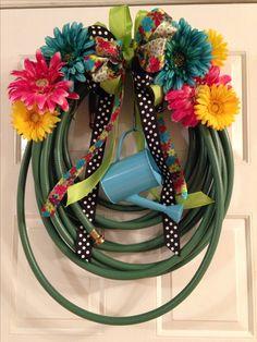 Spring garden hose wreath
