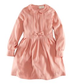 Dress in softly draping woven viscose with a rounded collar, pleats at the front, a decorative bow at the waist, and box pleats in the skirt section. All for Children for HM.