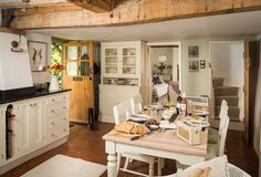 Cottage kitchen with rustic beams