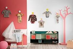 baby clothes on the wall
