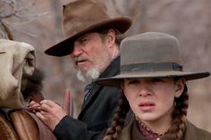 True Grit (2010) Jeff Bridges, Matt Damon, Hailee Steinfeld - Directors: Ethan Coen, Joel Coen - remake of 1969 version with John Wayne as Rooster Cogburn - young woman persuades US Marshal to hunt down her father's murderer. - REMOVED FROM 2013 EDITION