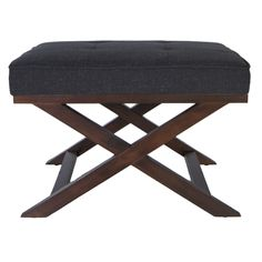 This handsome cross-leg bench ottoman provides a versatile addition to any decor. Beautiful crafted hardwood construction and a distinctive walnut finish make this ottoman a stylish and comfortable decorative accent for any home or office.