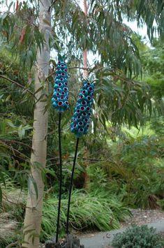 It's both. :) Ceramic sculptures by Frances Doherty, the Ceramic Gardener. (purple pom pom) (lime green pom pom) (thistle) (towering bells) (scarlet bottle brush)