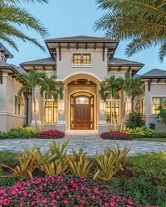 A balance of classic and timeless design styles this house nestled in lush tropical foliage and gardens by Architectural Land Design. This home also features a one-bedroom guest cabana with its own kitchen and bath. Coastal Color Palettes, Coastal Colors, Florida Homes Exterior, Warm Grey Walls, Florida House Plans, Serene Bedroom, Florida Design, Highland Homes, Tropical Landscaping