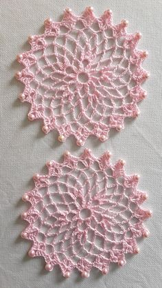 A lovely pair of small beaded doilies in pastel pink with matching glass beads. Handcrafted in lace-weight cotton in the traditional Spinning Wheel pattern, these delicate doilies are still practical as well as pretty. Each measures approx. Free Crochet Doily Patterns, Crochet Circles, Beading Patterns Free, Crochet Motif, Crochet Designs, Embroidery Patterns, Crochet Dollies, Crochet Flowers, Crochet Home