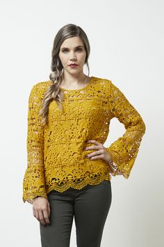 This gorgeous lace top will make any outfit special - long flare sleeves with scallop hem and a V keyhole back. Includes a cami under layer in matching colour.  Pair with your favourite necklace for a great night out. Mustard is the colour of the season. Shoulder to front hem approx. 63cm - Size 12 Across bust approx. 52cm Content: 100% Polyester Care: Hand wash according to instructions