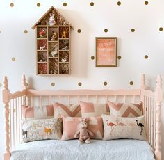Gold dots with a lovely shade of pink add a whimsical feel to this room   Empire Lane