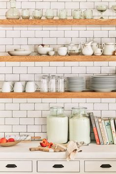 Love the mint decor with cream cabinets // rustic open wooden shelving in farmhouse style kitchen