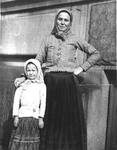 YMCA Social Worker  Ludmila Kuchar Foxlee dressed in peasant garb with an immigrant girl.1920 Ellis Island. Ms. Foxlee served from 1920-1937.