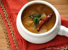 varuthu arucha kozhambu (ash gourd and lentils in spices and coconut gravy)