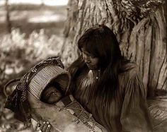 Apache mother and baby, photo by Edward S. Curtis