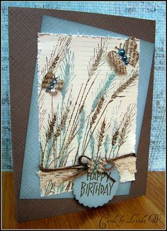Stamped both the card base and blue layer with tone on tone envelope pattern. Stamped the grasses in Frayed Burlap and clear embossed, then overstamped the blue ones. To get that shade of blue I combined Broken China and Weathered Wood Distress Inks. Butterflies are stamped with the Happy Definition. Hero Arts: S5507 Envelope Pattern CG269 Happy Definition S5316 Silhouette Grass A2153 Little Happy Birthday (2001) PS563 Mocha Folded Cards PS623 Sea Layering Papers