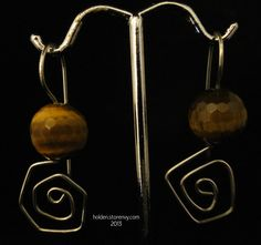 """Super Faceted Round Tiger Eye entwined in a hand forged spiral Sterling Silver ear wire. A winning combination! 1 1/2"""" in length."""