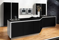 #LGLimitlessDesign #Contest - I think the shape of this kitchen island would lend itself well to my scifi dream kitchen. I'd make some adjustments to the colors and materials, however. I think the top should be a dark granite and the white area should be the same material as the cabinets, as shown in another pin. Then, for the front panel, I'd like that to be brushed metal the same color as the black stainless steel LG appliances, but with a hatched or swirled texture to it.