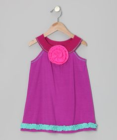 A pretty pick for a pretty princess, this colorful dress comes in a smooth rayon blend that'll always slip on comfortably and hang just right.60% polyester / 35% rayon / 5% spandexMachine wash; hang dryMade in the USA