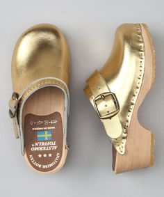 Sent straight from Sweden with love, these glamorous golden clogs are just the thing to keep tiny feet looking sweet. Produced with natural grain leather, they boast a raised alder wood arch for superior support and a movable heel strap that will keep toes click-clacking along in secure style.